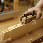 The shakuri kanna (plow plane) is used to form a narrow groove for the glass panels.