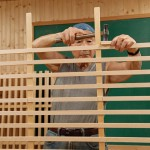 The horizontal braces pass through mortises in the vertical lattice pieces.