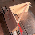 The first tenoning jig I built years ago. It's seen a lot of use on my table saw and my router.When I went to build a new jig, I realized that this one served me so well that I didn't need to add any more features to make it more useful.