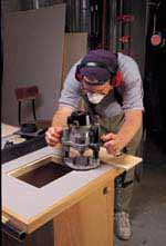 Routing the Plate Opening: A good way to get a parallel and square opening is to use the saw fence as a guide for two of the cuts. Measure the offset from the edge of the router base to the side of the spiral bit and use this in setting the fence for each cut, parallel to the fence. Clamp a square piece of wood in place as a guide for the sides of the opening, perpendicular to the saw fence. Next form the rabbet that holds the insert in place by using the same procedure and bit you used to cut the opening