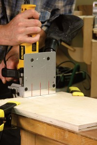 To keep from tilting the machine when making a vertical cut, extend your pencil marks so you're lining up with the center mark on the base, not on the fence.