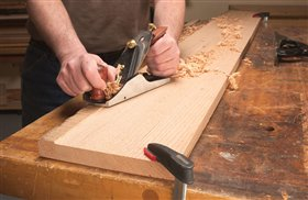 5. Hand-plane the uncut strip of wood flush. Skew the plane so its heel rides on the jointed surface of the board. A power hand planer will also do the job.