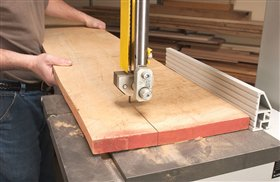 6. Rip a wide board into jointer-sized pieces on the bandsaw. Make sure the board has one straight edge to go against the fence. Make the cut where the grain runs straight on the board. That way, the joint will be less visible when the board is glued back together.