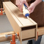 6. Place the second bottom piece on the clamped-up beam. Run a thick bead of glue down both grooves.