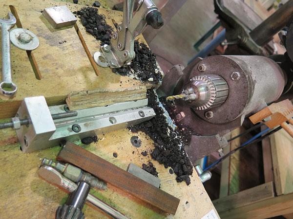 A horizontal boring machine for boring handle stock.