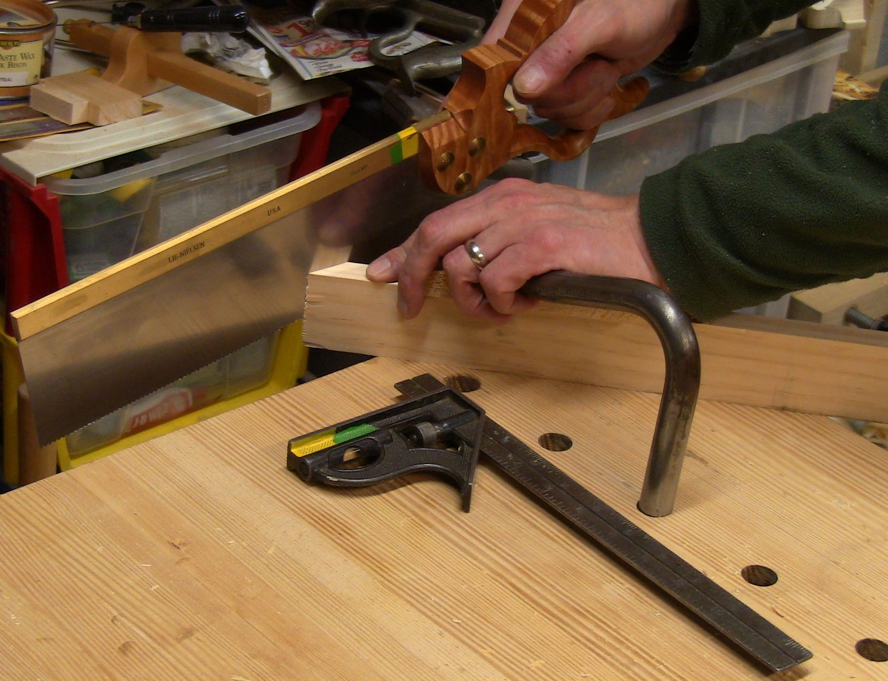 Rough sawing a miter on the end of a face strip.