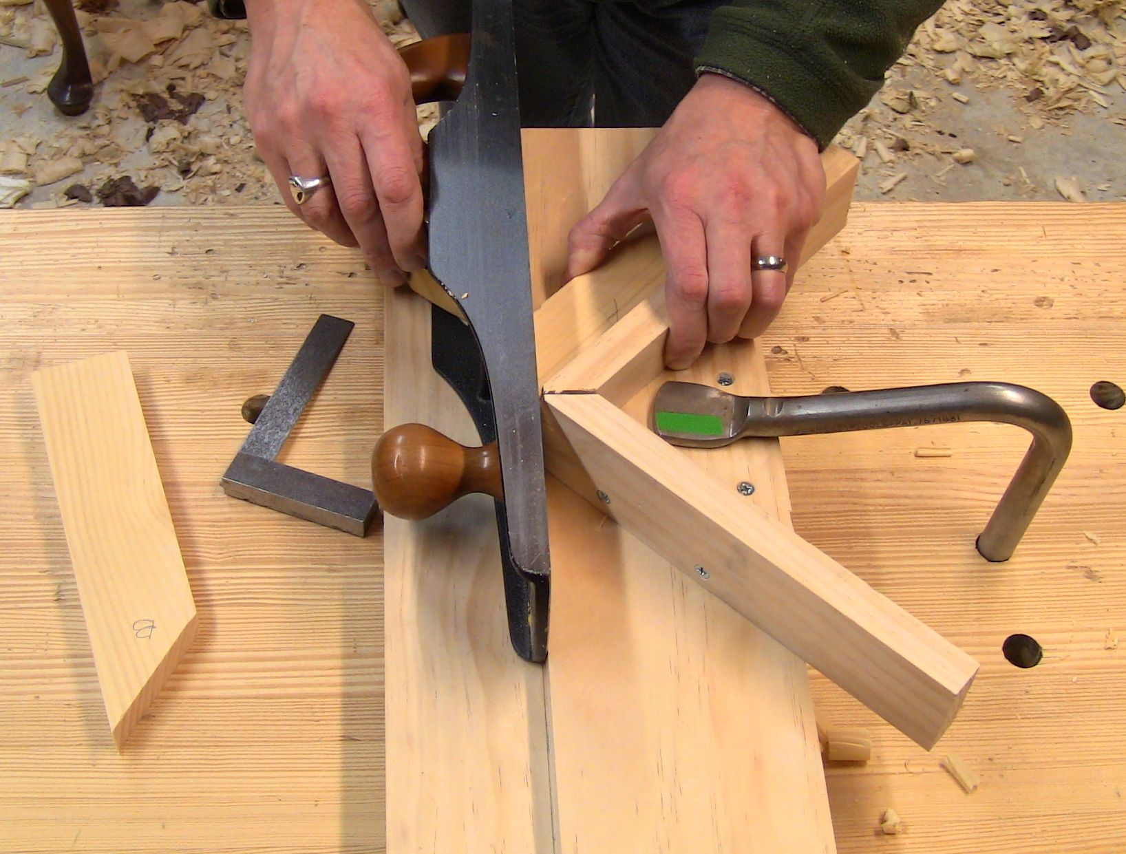 Shooting a miter on a test piece.