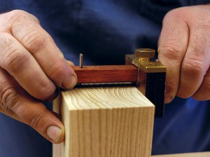 Use a marking gauge to establish the length of the tails on the pin board.
