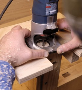 """A trim router with a 1⁄4"""" upcut spiral bit gets rid of most the initial waste."""