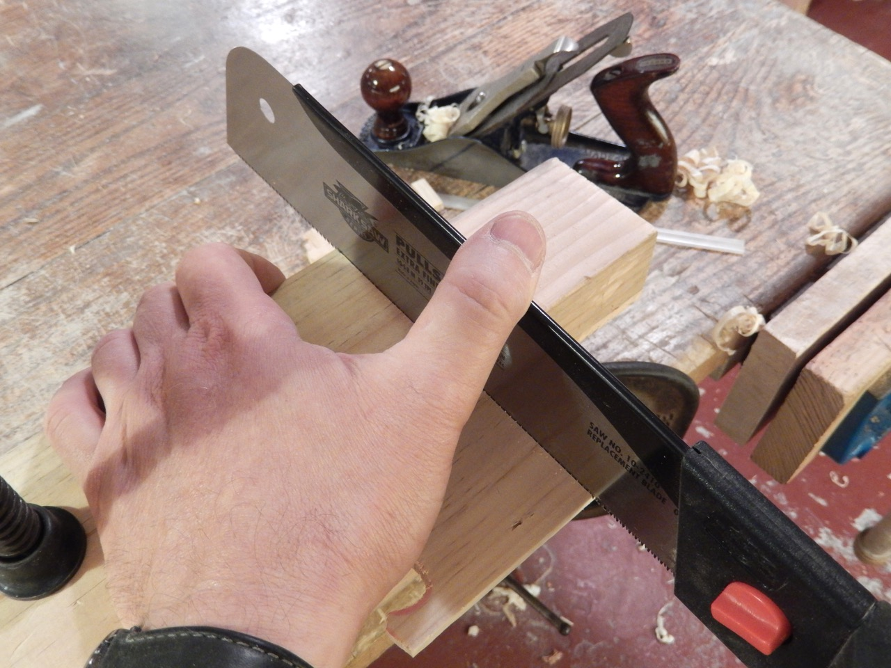 """Putting light pressure on the saw's spine will eliminate any chance of the saw jumping out of the """"V"""""""
