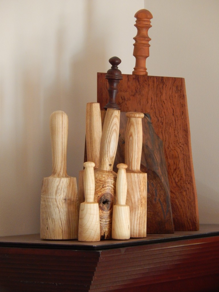 """My """"family"""" of mallets and two of my turned handle cutting boards  reside on top of our kitchen cabinets."""