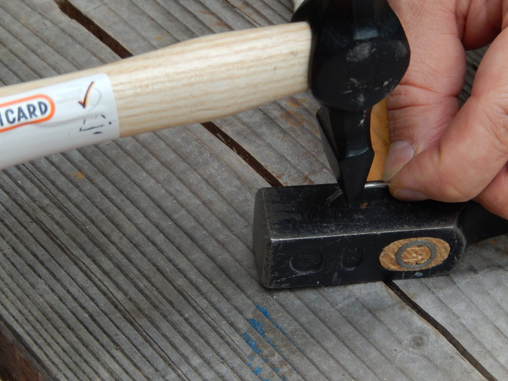 I use the hammer peen to correcting a delinquent nail back in straightness