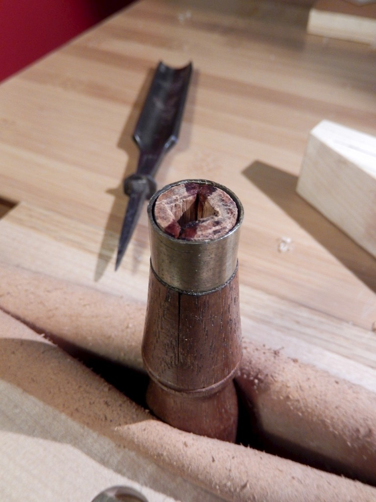 Inserting the ferrule over the handle's shoulder