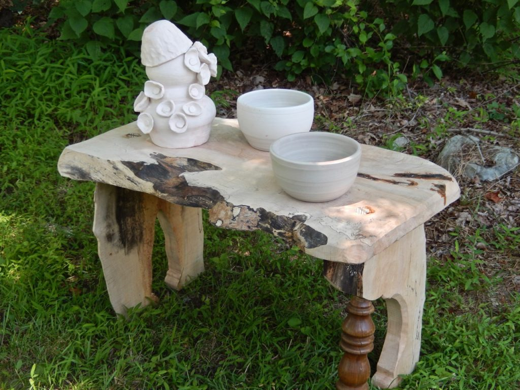 Beautiful handmade ceramic makes this bench look even more dashing.