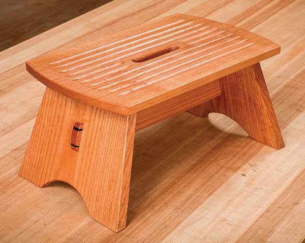 This small stool, designed by eye and built by hand, satisfies my four criteria: Sized to fit my foot and step; stable for all potential foot positions; durable and strong enough to support more than my weight; and offering a non-slip step surface.