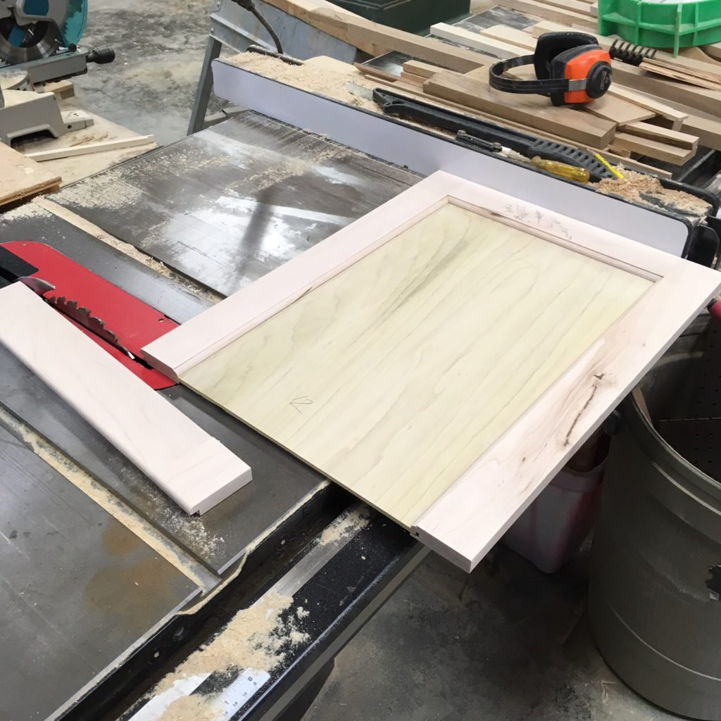 Cut the door to size on the table saw for a quick fix