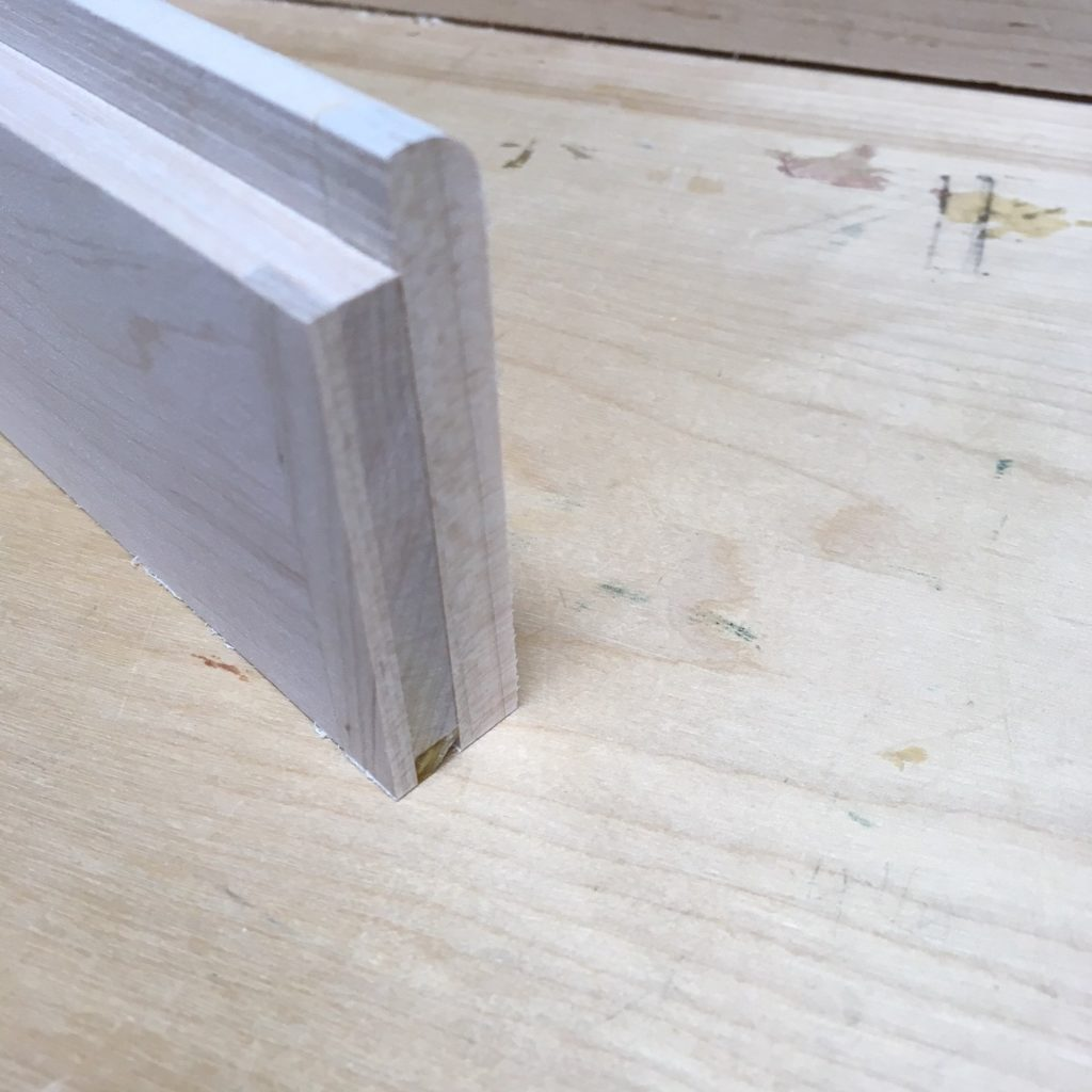 The rail trimmed back to original length, including the tenons at both ends, is part of a quick fix