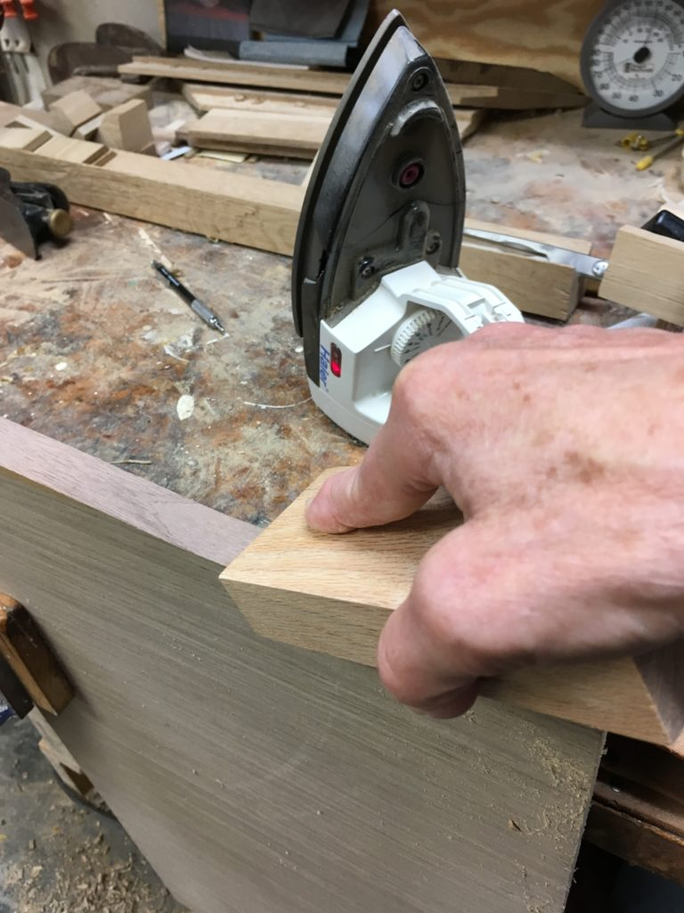 edge banding architectural veneer in a small shop