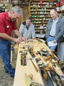 Deneb Puchalski of Lie-Nielsen Toolworks and two woodworkers enjoying a Hand Tool Event.