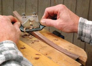 Smooth moves. Angle your spokeshave in the cut to lengthen the amount of blade that touches your work as you smooth curves.