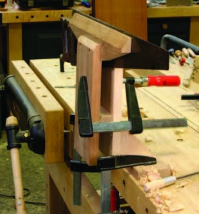 Three clamps. Two F-style clamps hold the vise to the bench, the third tightens the jaws. Keep the handle of the third clamp away from you.