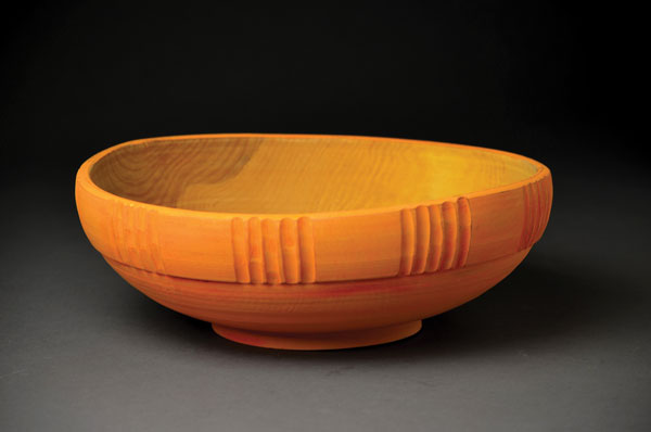 "Wooden language. This simple yet elegant wooden bowl captivates both hand and eye. This piece, ""Orange Bowl,"" is by Jim Sannerud."