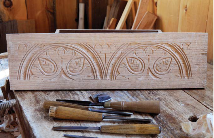 Box front. Featured in this carvings are two lunettes with fl oral motifs. All it takes is some basic geometry, four carving tools and a punch. And practice.