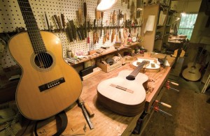Rasps, files, glue, chisels and carving tools make up the bulk of the equipment in Clark's small shop, all stored within easy reach of his handmade workbench.  In front are two of the 10 flamenco-style guitars Clark has made.  A template awaits his next instrument at the far end of the bench.
