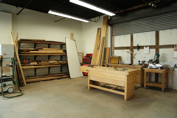 "The lumber rack and ""video corner"" (behind which you can see the top of the old garage door...I miss it so)."