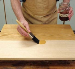 """Brushing polyurethane finish is as simple as """"going with the grain."""""""