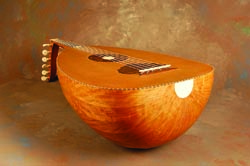 This oud has a figured cherry bowl and spruce top.