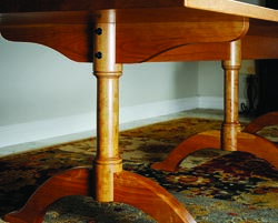 Jameel recently completed this 10'-long Shaker dining table in cherry. Three pedestals support the large top. Details included turned posts and pedestal feet.