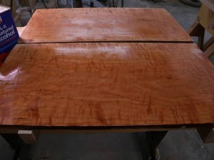 curly cherry lumber with denatured alcohol shows the figure