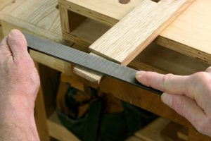 Adjust a tenon with a file
