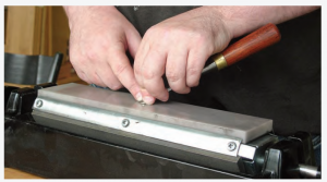 Joel Moskowitz advocates for the freehand method in tool sharpening.