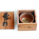 "Toshio named his tea-cup ""sezzai"" (standing in snow) & made this box with aromatic Cedar; caligraphy was written by the known chisel maker Iyoroi. In this way Kato's tea cup was given a name, and placed into a paulownia box."