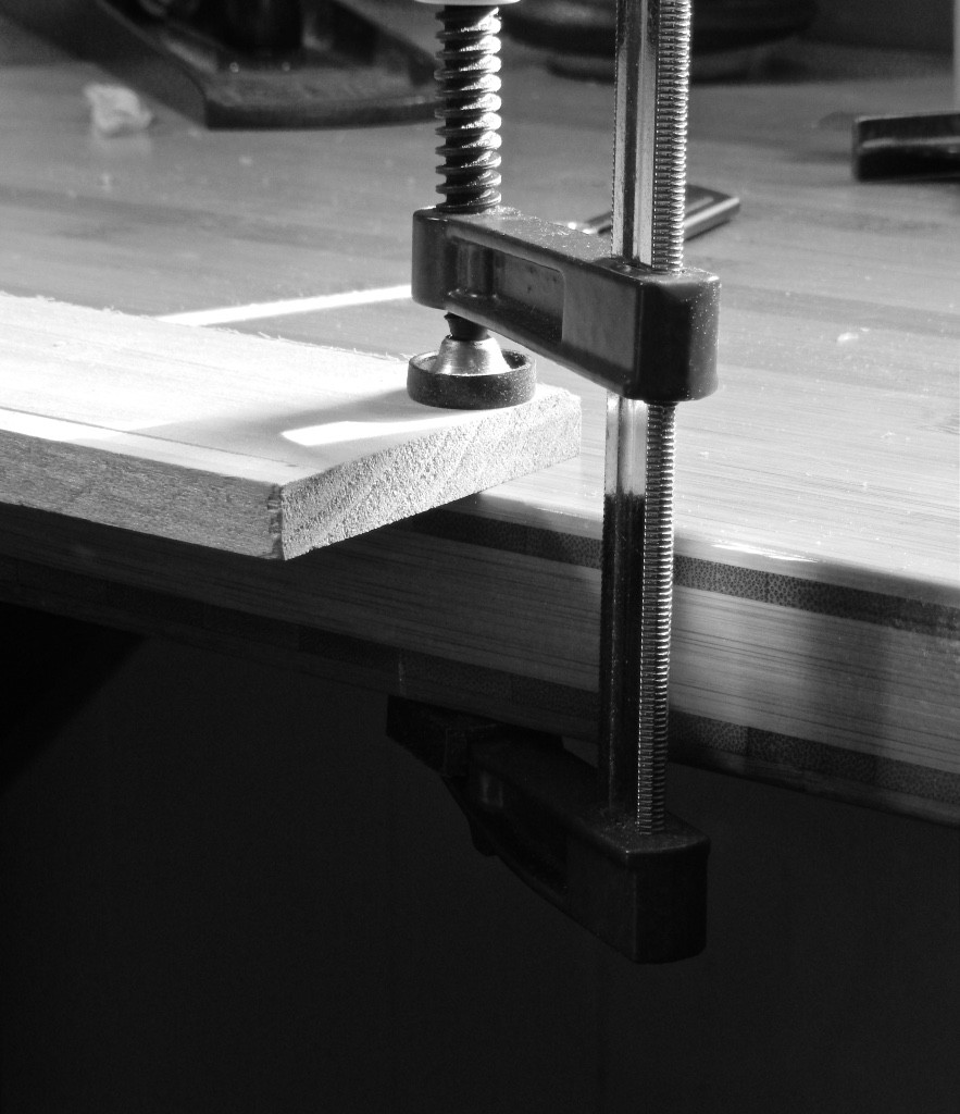 Without holdfast capabilities it is difficult to clamp thin and narrow work piece from the edge of a bench for wide chamfering, grooving and rabbeting. The clamps that hold the piece down will be in your way and the work piece will hang too far out in space and might  break or flex. To overcome these situations we use our Bench bulls.