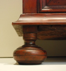 Straight-on shot of foot and moulding detail.