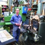 Chris Vesper's small shop and home are filled completely with old tools, his machinery and his book collection.