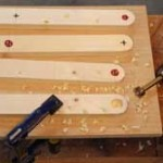 Clearly marked. The holes that get countersinks (all exterior-facing bolt holes) are marked with a different colored ink.