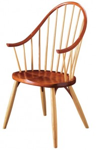This iconic chair is trademarked as the Thos. Moser Continuous Arm Chair. It is further protected by a design patent.