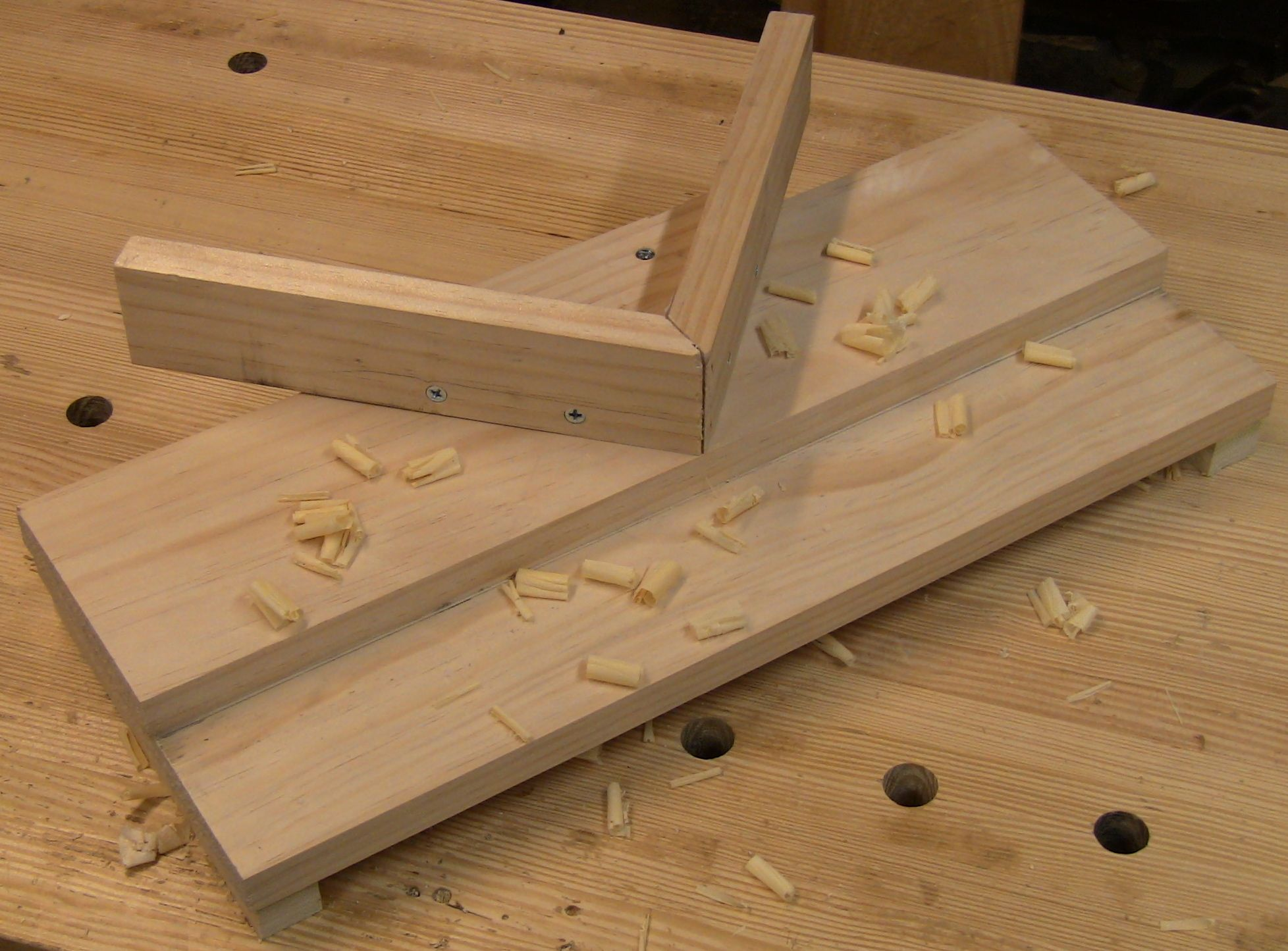 A miter shooting board with added shimmable faces.