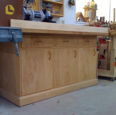 Shop cabinet with Rod Layout board setting atop it.