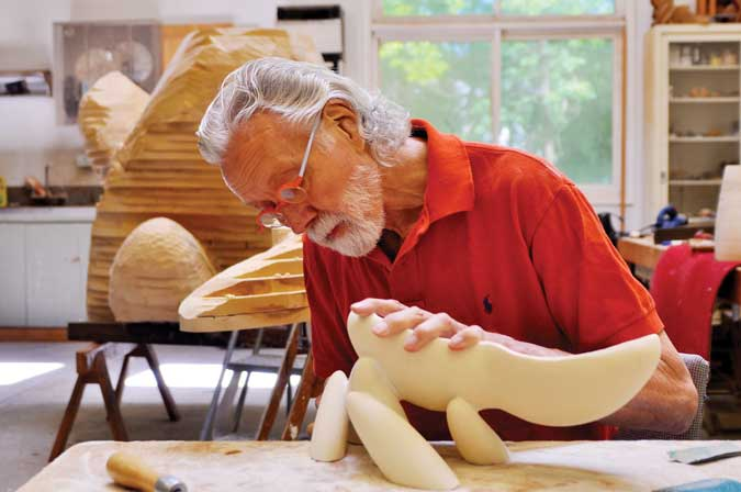 A prolific life. At almost 80 years of age, Wendell Castle's production is still substantial. Here he works out the details for one of his recent stacked laminate pieces.