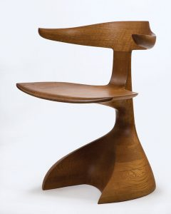 Early stacked piece. This early armchair from 1967 is made of solid oak stacked and laminated in what would become a common Castle technique.
