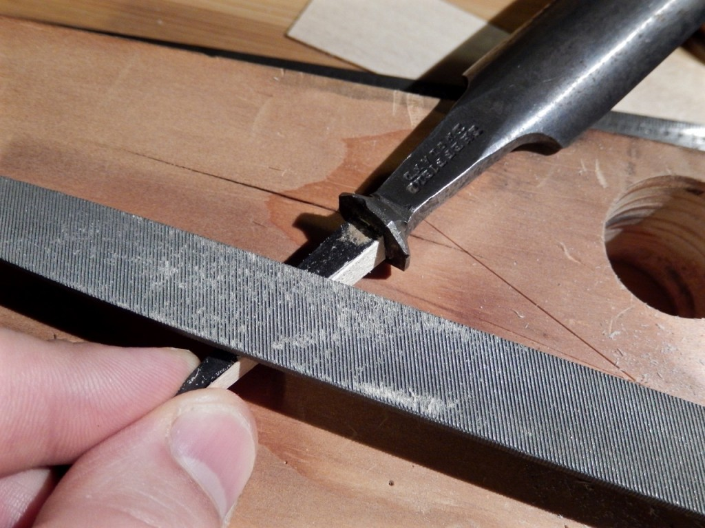 FIle the first shim flush with the tang before gluing the adjacent shim
