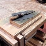 My sandpaper plate sharpening system is made of two plates and a  piece of 600 grit sandpaper.