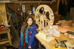 Woodworking projects for kids are better when tailored to interests! Jaida and her Ferris Wheel.