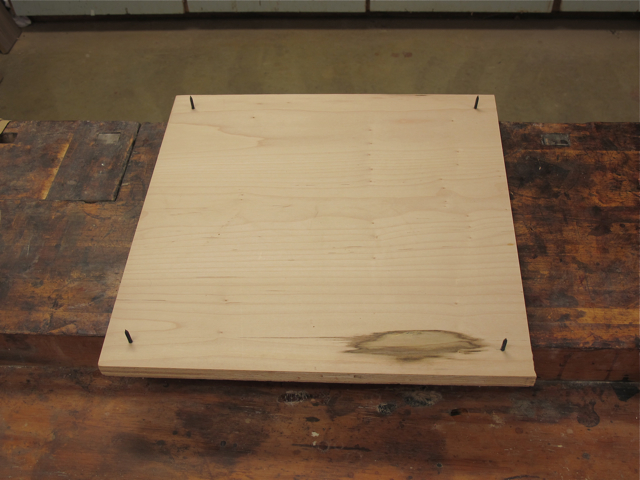 Make a nail board approximately the size of your panel or cabinet door ...