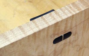 Wedged through-tenon. A handle attached with a wedged through-tenon adds visual interest on the inside – and it will stay in place.